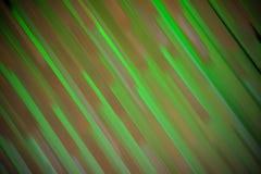 在绿色和橙色口气的抽象背景 免版税库存图片