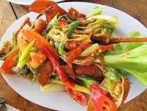 在黄色咖喱的油煎的螃蟹 免版税库存图片