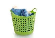 在绿色塑料篮子的织品 库存图片