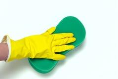 在黄色手套的一只手 免版税库存照片