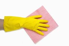在黄色手套的手 图库摄影