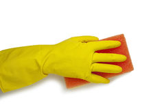 在黄色手套的手 免版税库存图片