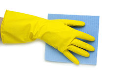 在黄色手套的手 免版税库存照片