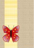 在黄色格子花呢披肩丝带的蝴蝶在亚麻制背景 库存照片