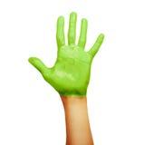 在绿色油漆的手 免版税库存照片
