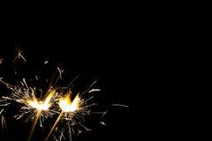 在黑色的三个明亮的欢乐圣诞节闪烁发光物与自由空间 免版税图库摄影