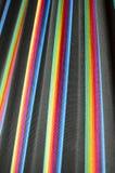 在黑色的五颜六色的彩虹条纹在温暖的口气 库存图片