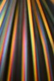 在黑色的五颜六色的彩虹条纹在温暖的口气 免版税库存图片