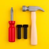 在黄色的塑料儿童玩具工具 免版税库存照片