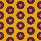 在黄色的平的无缝的背景样式音乐乙烯基圆盘 库存照片