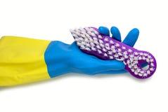 在黄色的手套的手蓝色和 库存图片