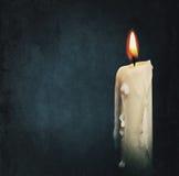 在黑色的灼烧的蜡烛 免版税库存照片