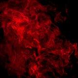 在黑色的红色烟 库存图片
