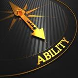 在黑色的能力概念与金黄指南针。 免版税库存图片