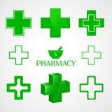 在绿色的药房标志在白色 库存图片