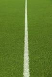 在绿色的足球场草 免版税库存图片