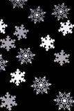 在黑色的雪花背景 免版税库存照片