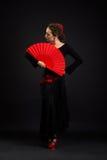 在黑色的年轻西班牙妇女跳舞佛拉明柯舞曲 免版税库存图片