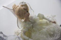 在黄色礼服的玩偶 图库摄影