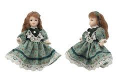 在绿色礼服的瓷玩偶 库存图片