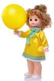 在黄色礼服的葡萄酒玩偶有baloon的 免版税库存图片