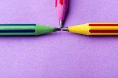 在紫色背景的五颜六色的铅笔 库存图片