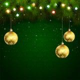 在绿色背景的圣诞灯 库存照片