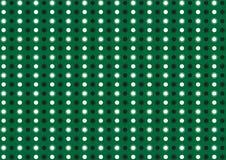 在绿色背景的抽象小点 免版税库存图片