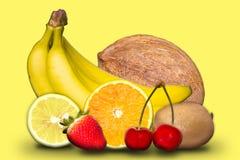在黄色背景的果子 库存图片