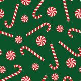 在绿色背景的棒棒糖和棒棒糖无缝的圣诞节样式 免版税库存照片
