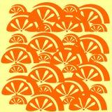 在黄色背景的橙色果子样式 免版税库存图片