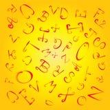 在黄色背景的混杂的字母表 免版税库存照片