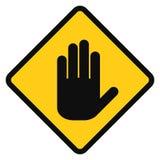 在黄色背景的象白色手 免版税库存图片
