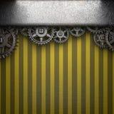 在黄色背景的链轮 免版税库存照片