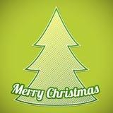 在绿色背景的绿色镶边圣诞树 库存照片