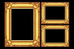 在黑色隔绝的三个古色古香的金木制框架 库存图片