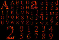在黑色隔绝的概念性红色灼烧的火字体 图库摄影