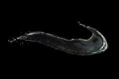在黑色隔绝的清楚的水飞溅 免版税图库摄影