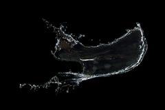 在黑色隔绝的清楚的水飞溅 免版税库存照片