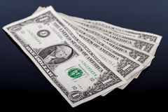 在黑色隔绝的美元钞票 库存图片