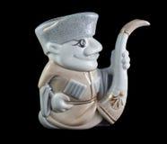在黑色隔绝的高地居民的陶瓷小雕象 免版税库存图片
