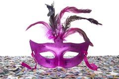 在紫色面具后 免版税库存图片