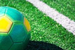 在绿色领域的一个足球 免版税库存图片