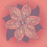 在紫色颜色的美丽的装饰花在橙色背景 免版税图库摄影