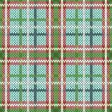 在绿色,红色和白色颜色的无缝的被编织的样式 库存照片