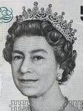 在5英镑钞票的英国女王伊丽莎白二世画象 库存图片