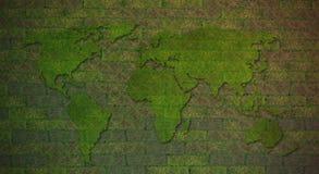 在绿草墙壁上的世界地图 免版税库存照片