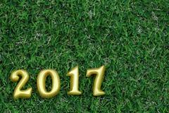 在绿草的2017个真正的3d对象,新年好概念 图库摄影