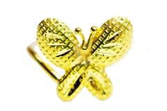 在蝴蝶形状孤立的金下垂有浮雕的贝壳花梢圆环首饰 库存图片