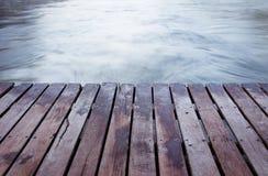 在水表面背景的木板条地板 库存照片